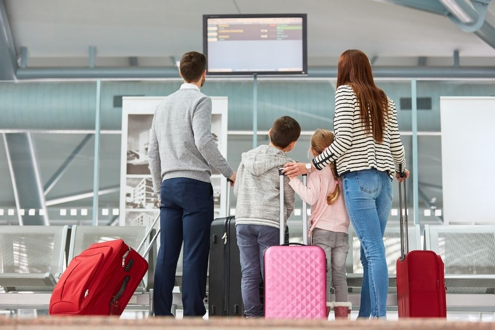 International Relocations with Personnel Relocations - family at airport